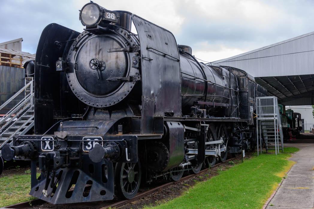 Black steam locomotive numbered X36