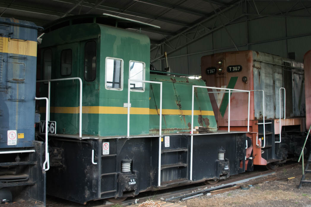 Green and yellow small diesel locomotive numbered V 56