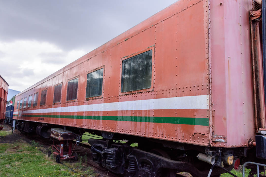 Orange carriage with green and white stripes labelled Mitta Mitta