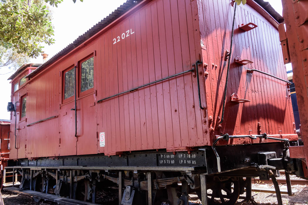 Red carriage with black underframe numbered 220 ZL