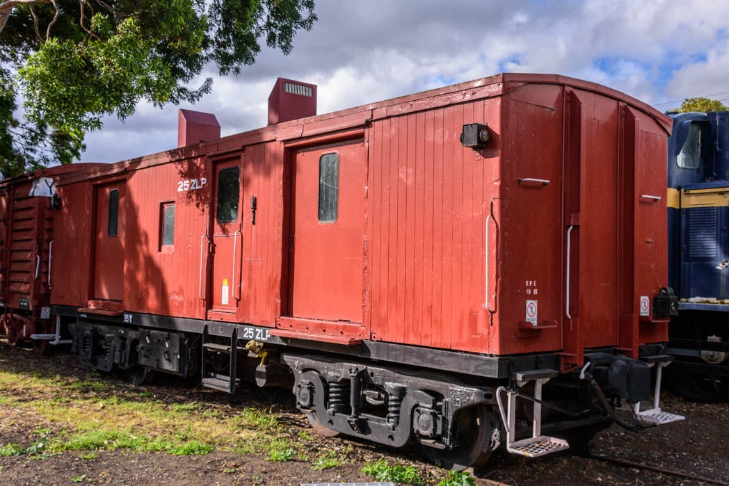Red carriage with black underframe numbered 25 ZLP
